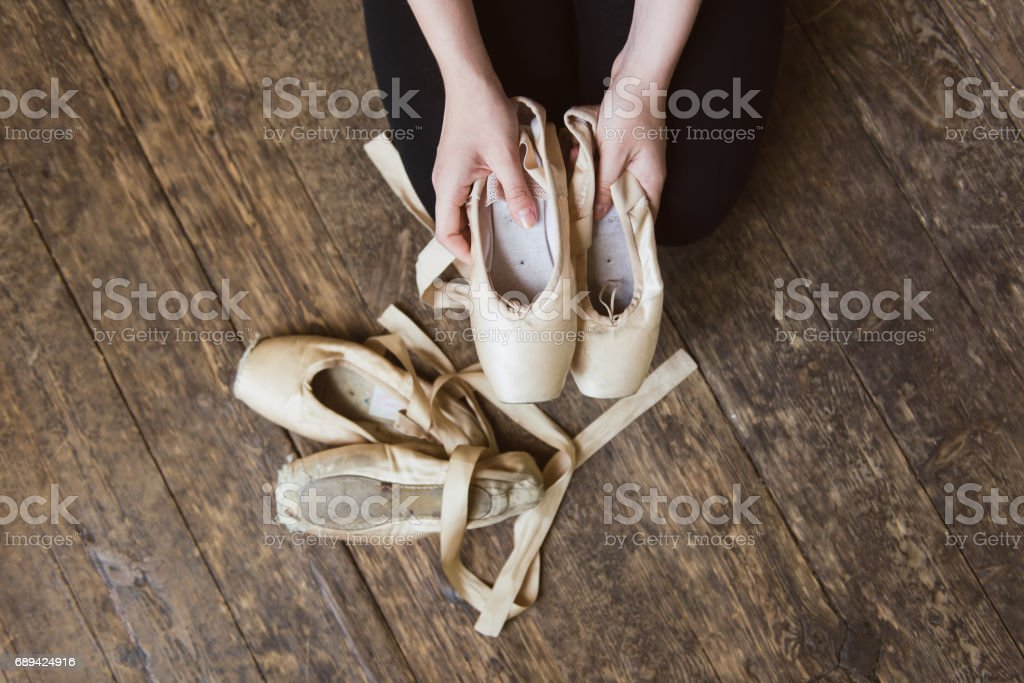 Ballet dancer holding a ballet pointe stock photo