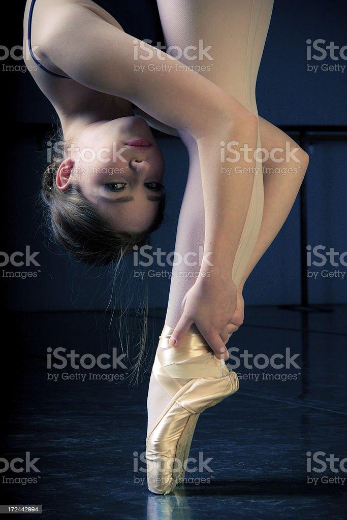Ballet Dancer in a Dark Studio on Pointe stock photo