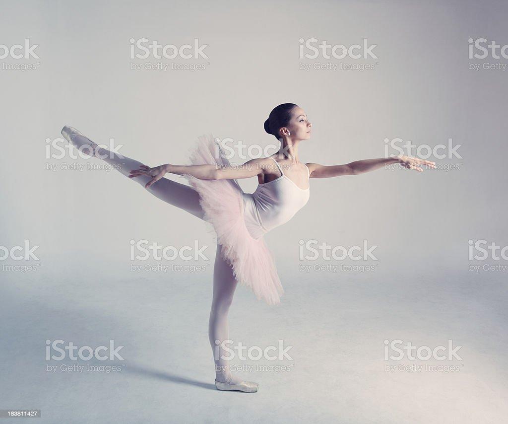 Ballet dancer in arabesque stock photo