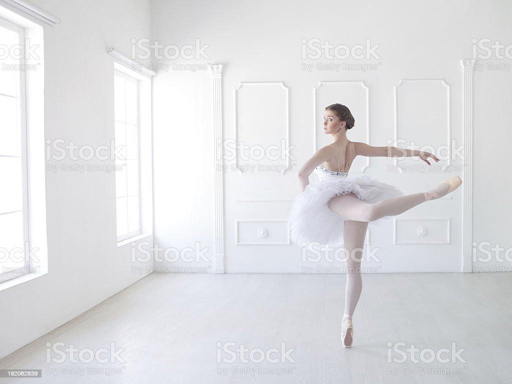 Ballet dancer in white studio stock photo