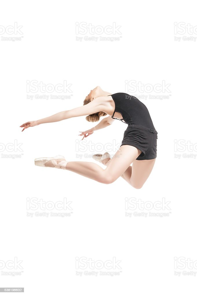 ballet dancer jumping in bend stock photo