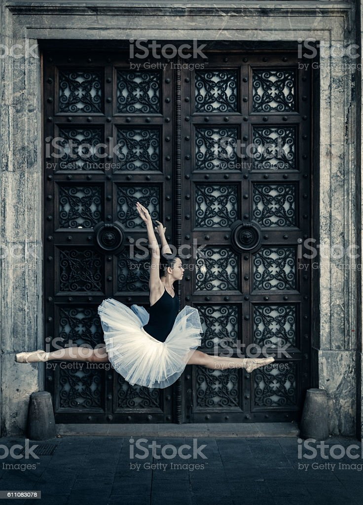 Ballet dancer jumping in the street stock photo