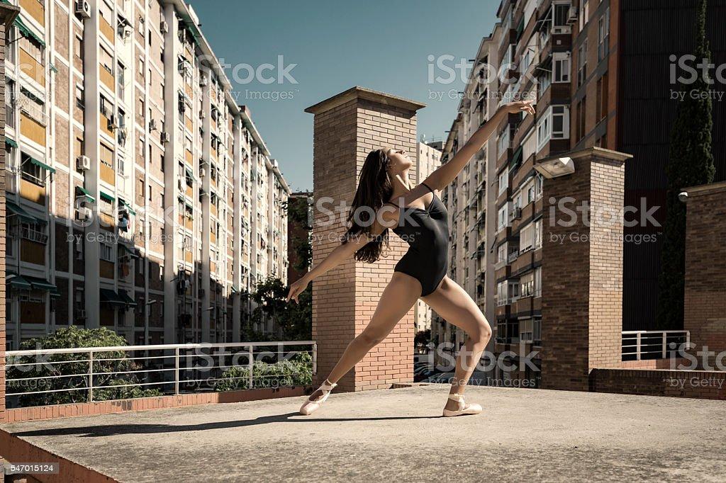 Ballet dancer performance in city suburbs stock photo