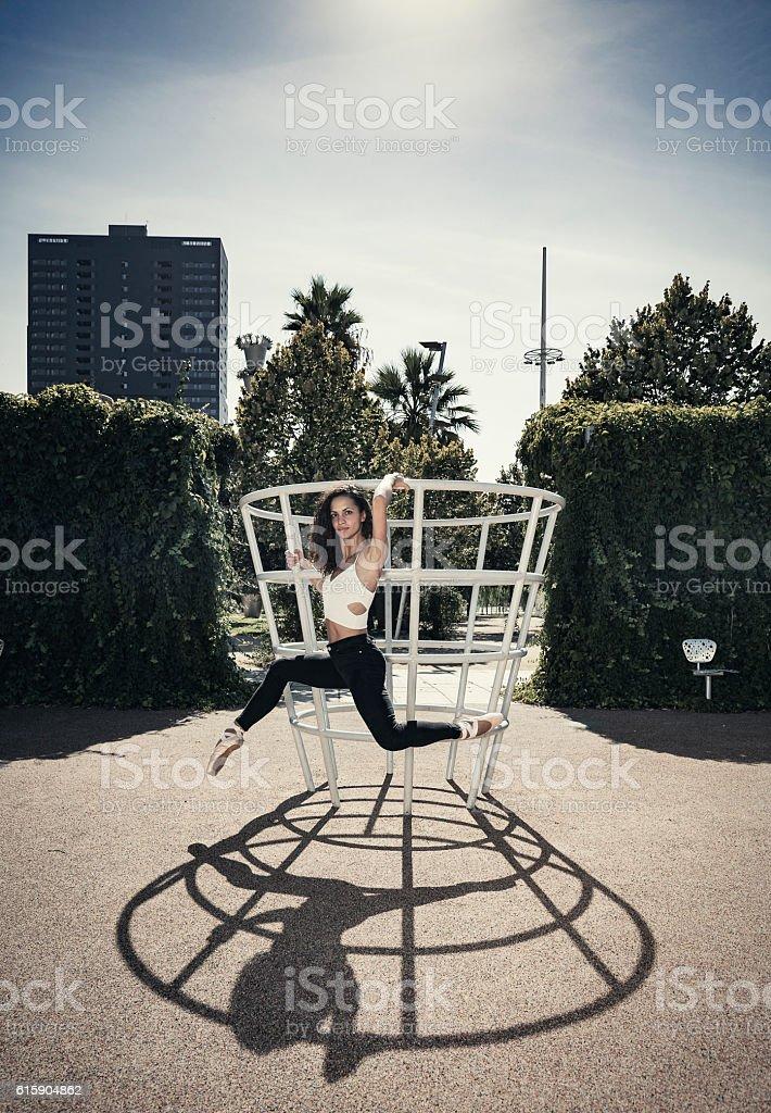 Ballet dancer performance in urban park stock photo