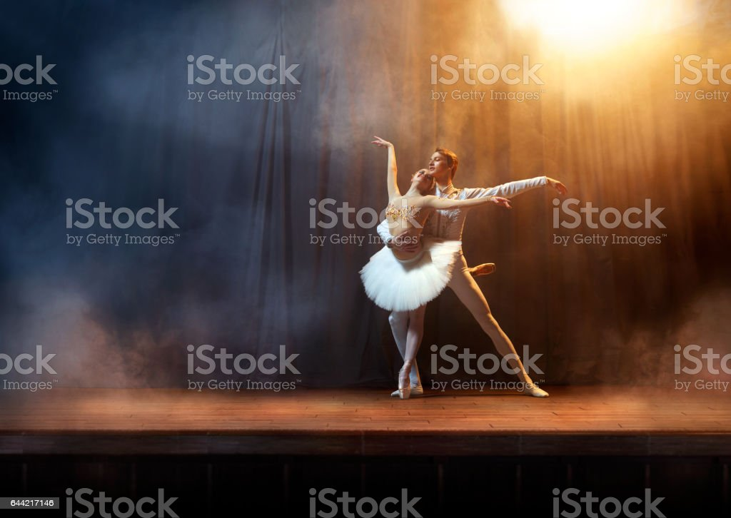 Ballet dancers performing on stage in theatre stock photo