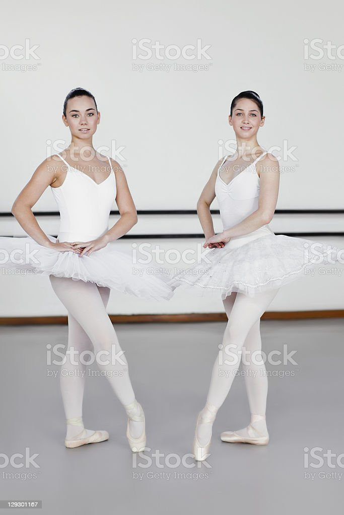 Ballet dancers posing together in studio royalty-free stock photo
