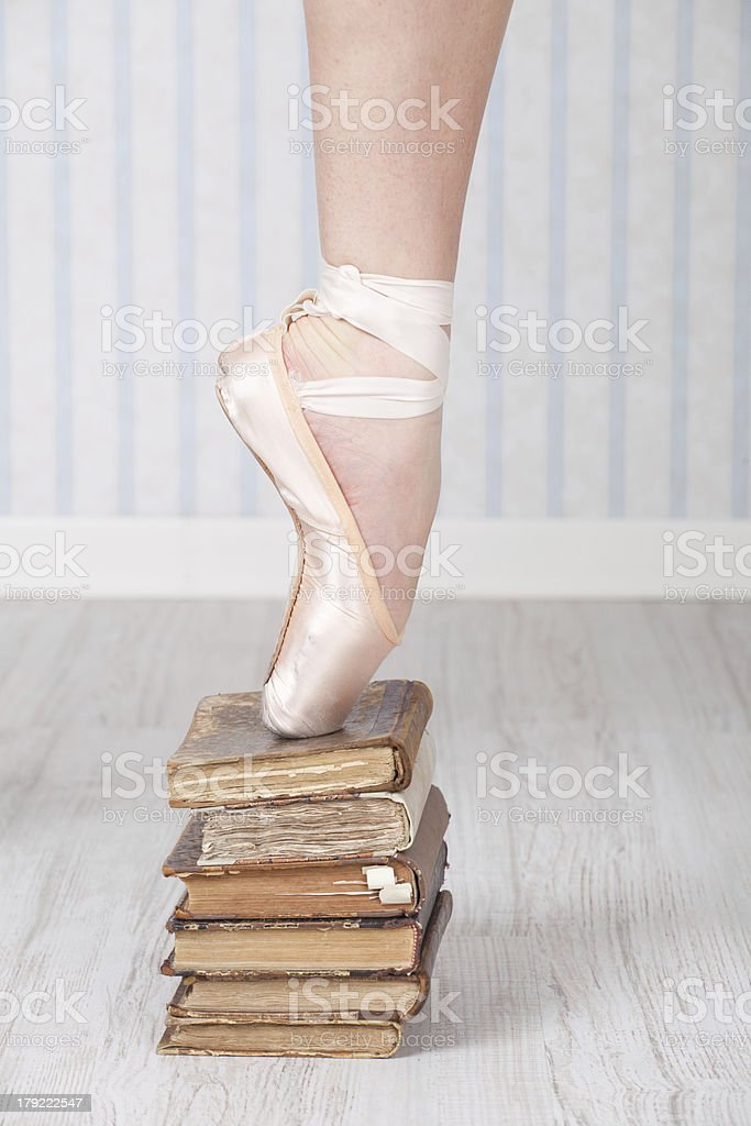 Ballet shoe on a stack of old books royalty-free stock photo