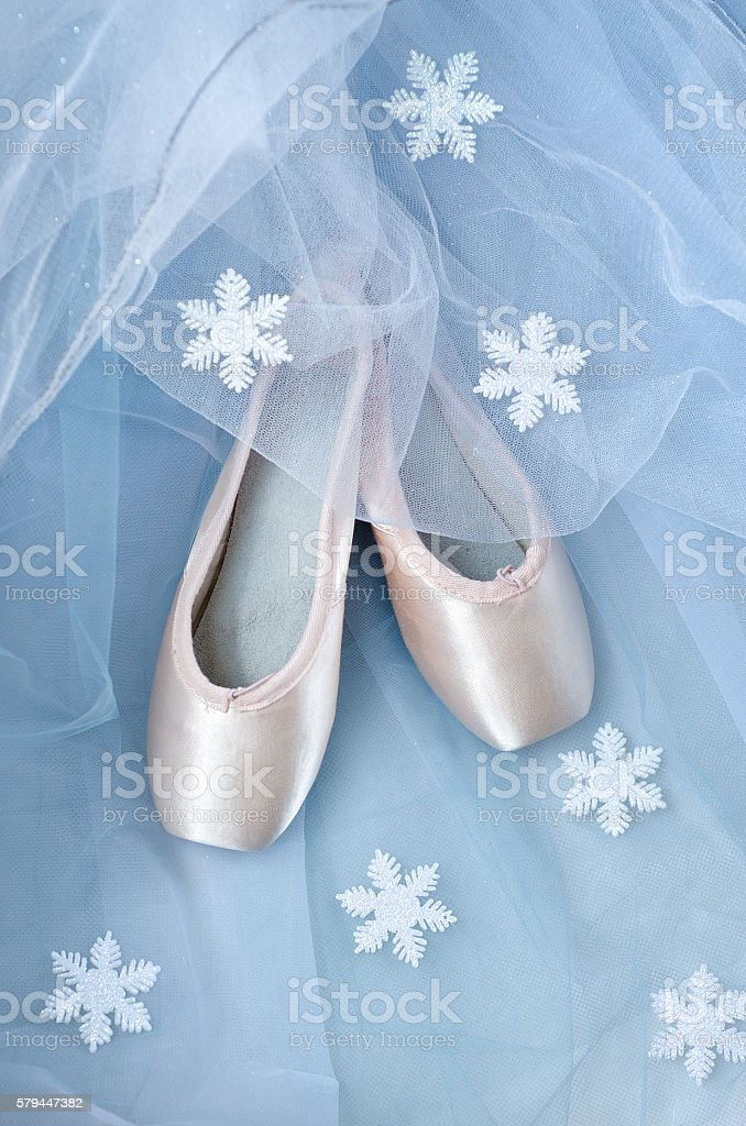Ballet shoes and snowflakes stock photo