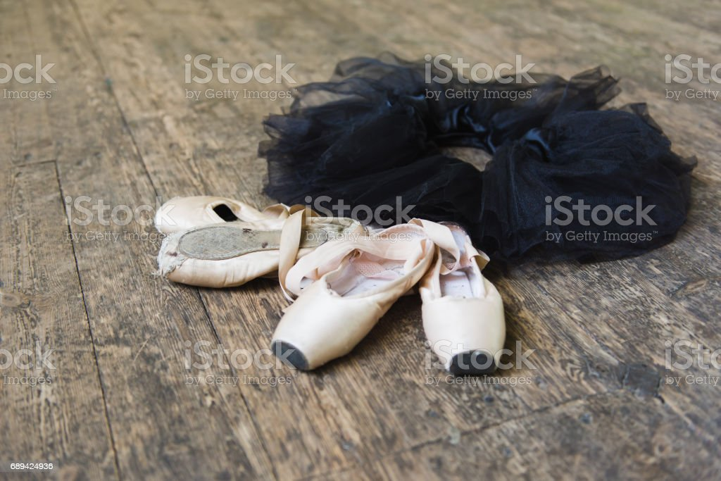 Ballet shoes and tutu on a wooden background stock photo