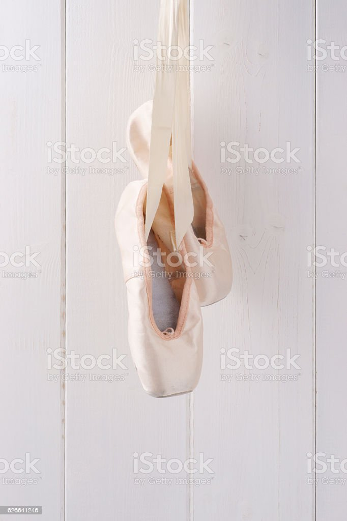 Ballet shoes hanging up stock photo