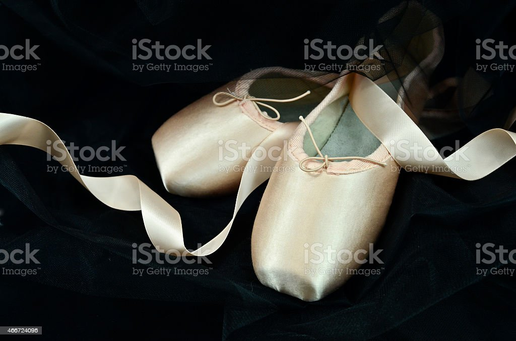 Ballet shoes on black background stock photo