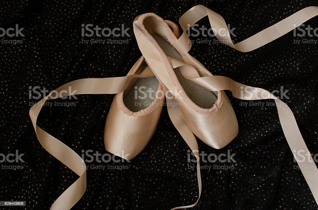 Ballet shoes on black stock photo