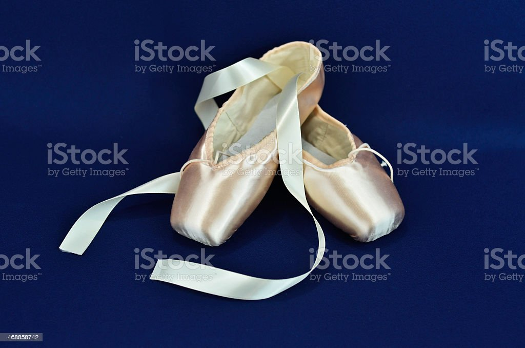 Ballet shoes on blue background stock photo
