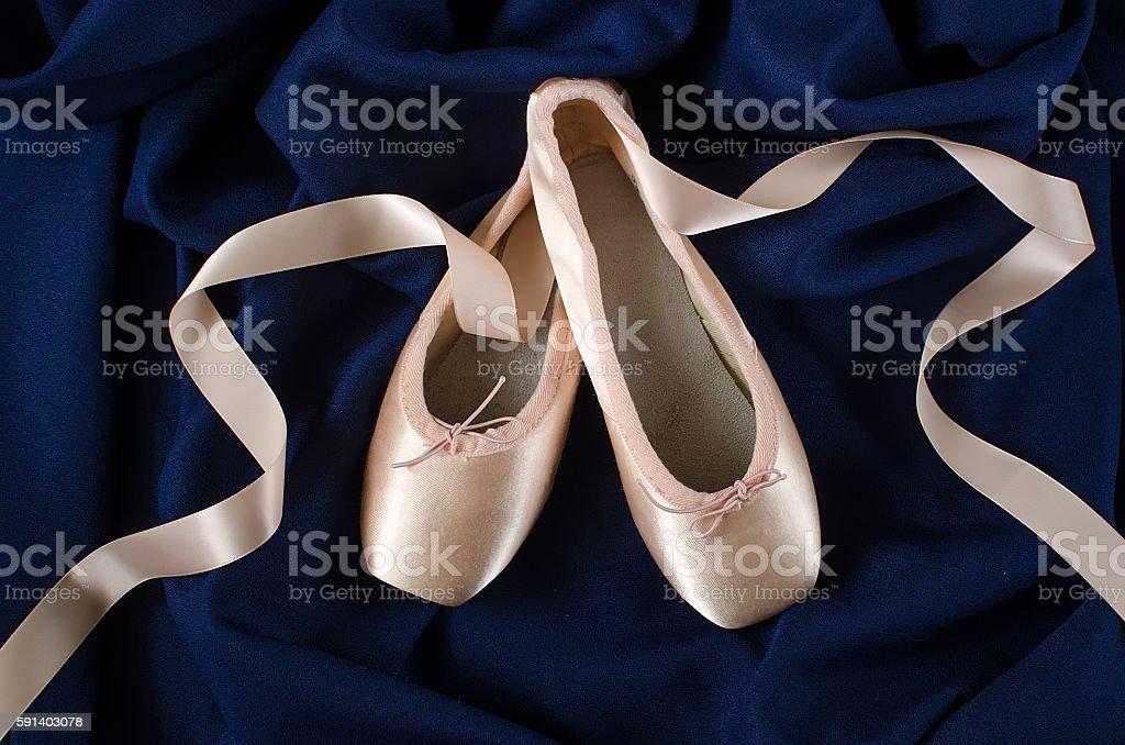 Ballet shoes on dark blue background stock photo