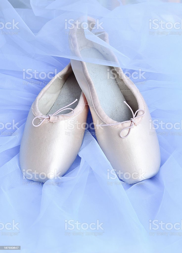 Ballet shoes on light blue background stock photo