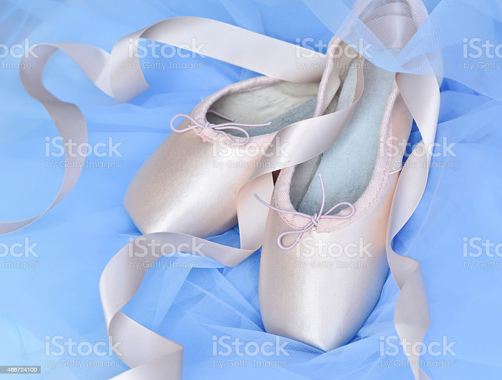 Ballet slippers and light blue tutu stock photo