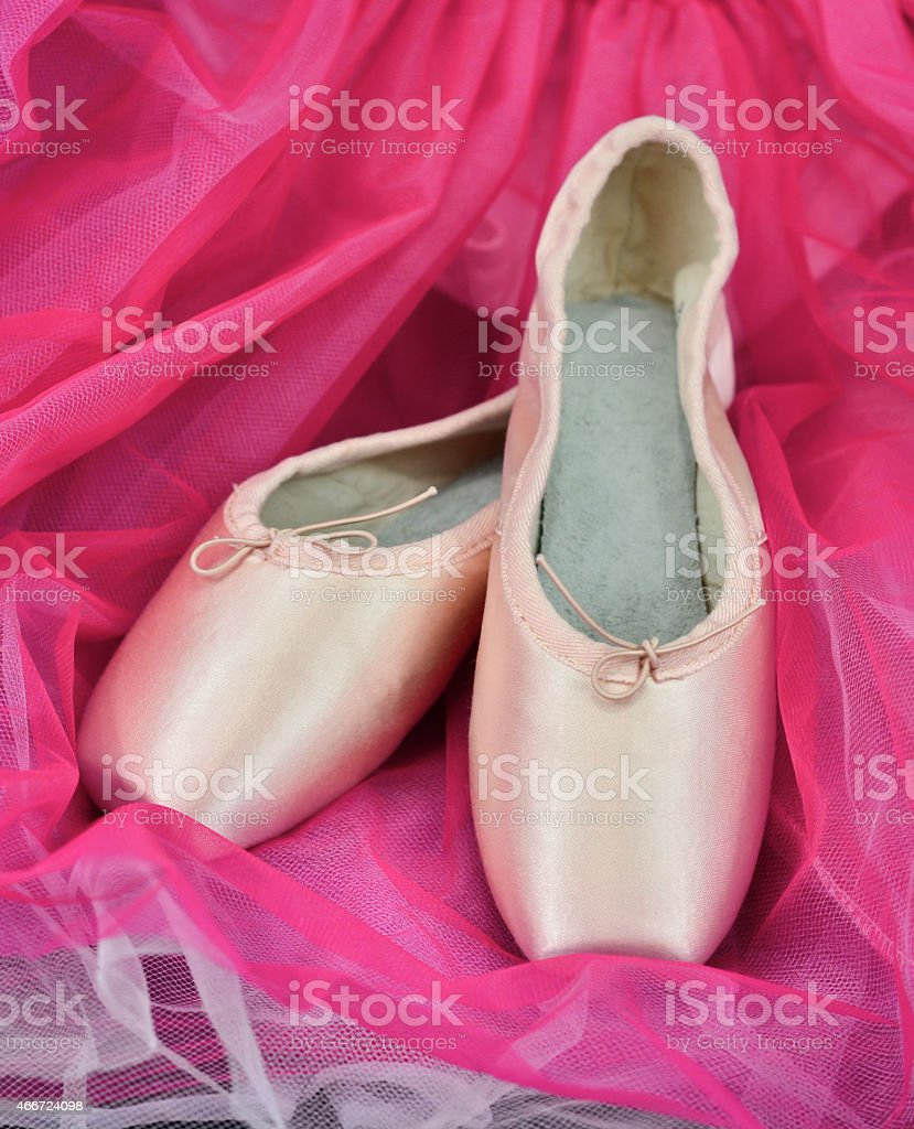Ballet slippers and pink tutu stock photo