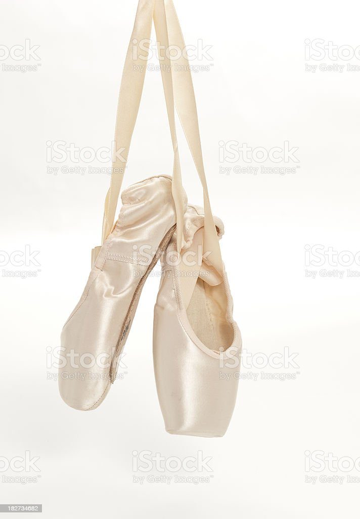 ballet slippers hanging stock photo