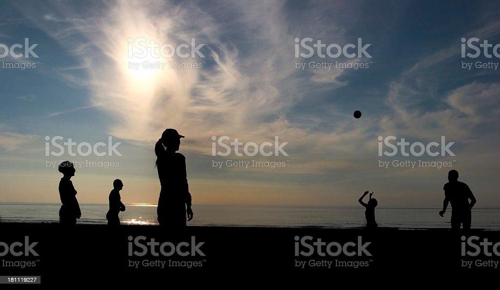 Ballgame on the beach royalty-free stock photo