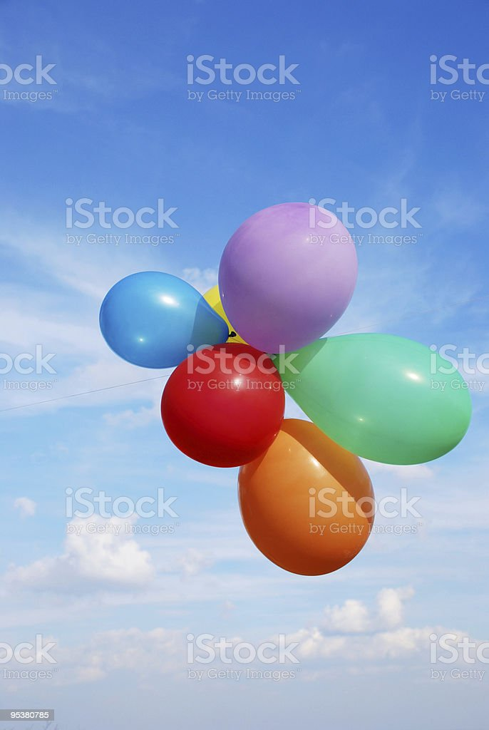 ballons  blue sky and white clouds stock photo