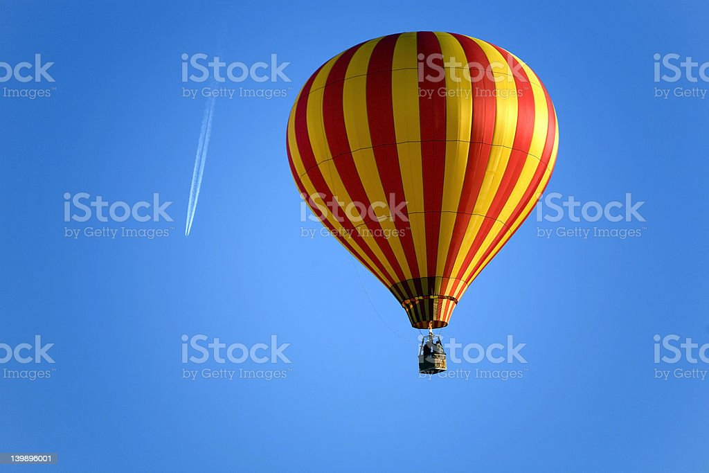 Balloon and an airplane on the blue sky royalty-free stock photo
