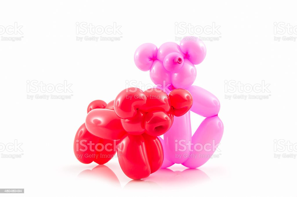 Balloon animal of red pig and pink bear. stock photo