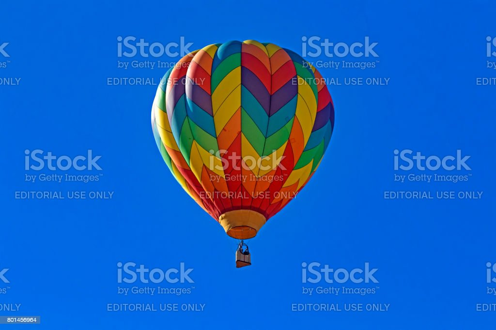 Balloon floats above festival in the morning stock photo