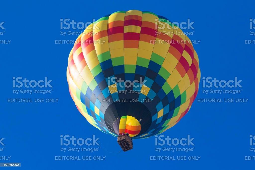 Balloon flyiing above at Hot Air Balloon Festival stock photo