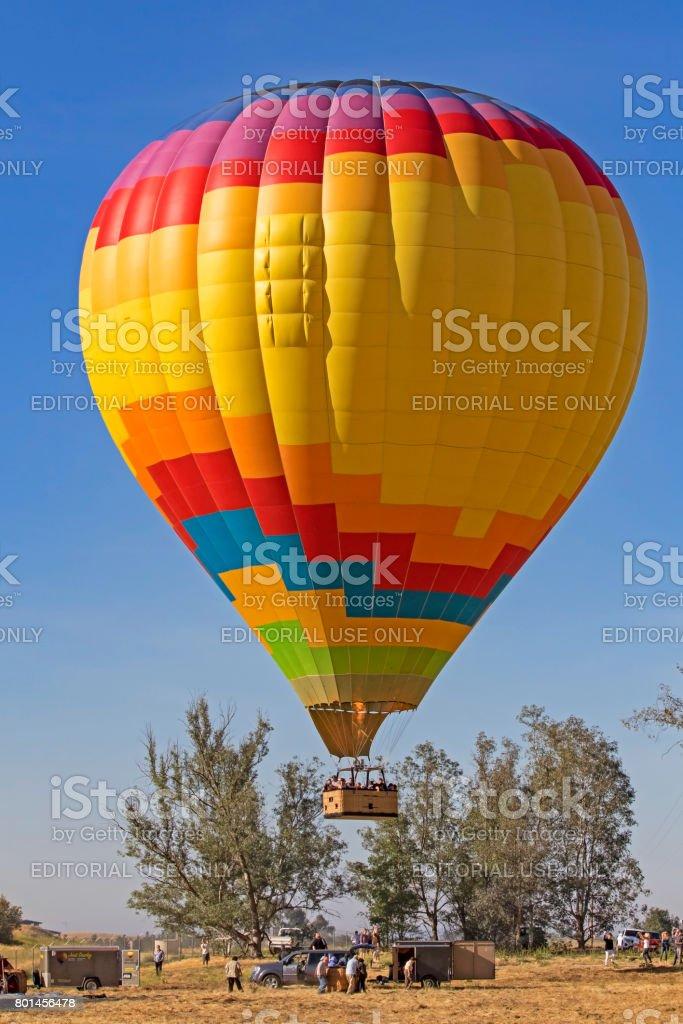 Balloon landing at Hot Air Balloon Festival stock photo