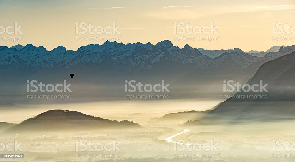 balloon over foggy borderland between austria and switzerland stock photo