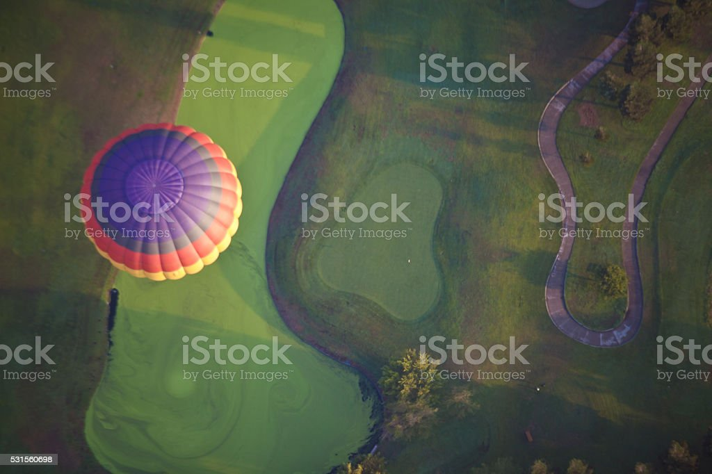 Balloon Over Golf Course stock photo