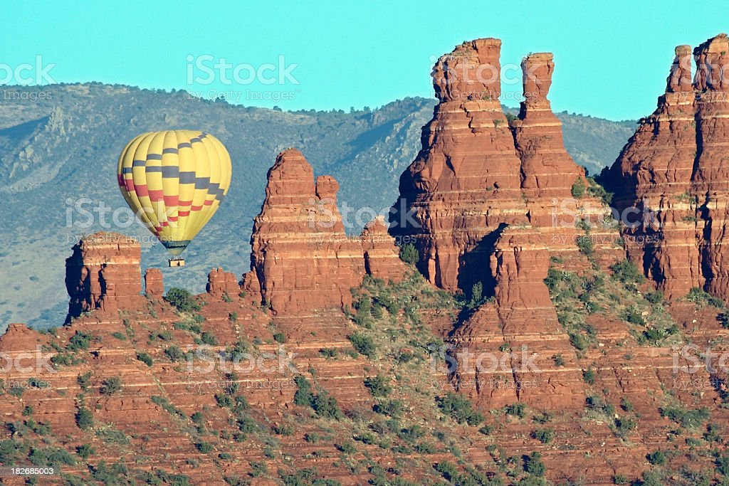 Balloon over red rocks stock photo