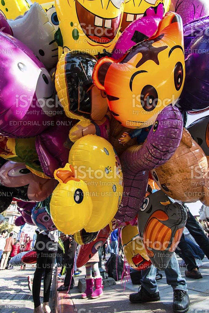 Balloon salesman seeling balloons to a little girl stock photo