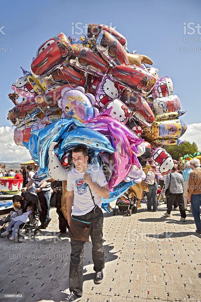 Balloon seller at festival in summer. stock photo