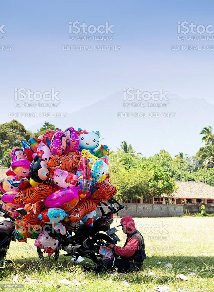 Balloon seller in Bali,Indonesia stock photo