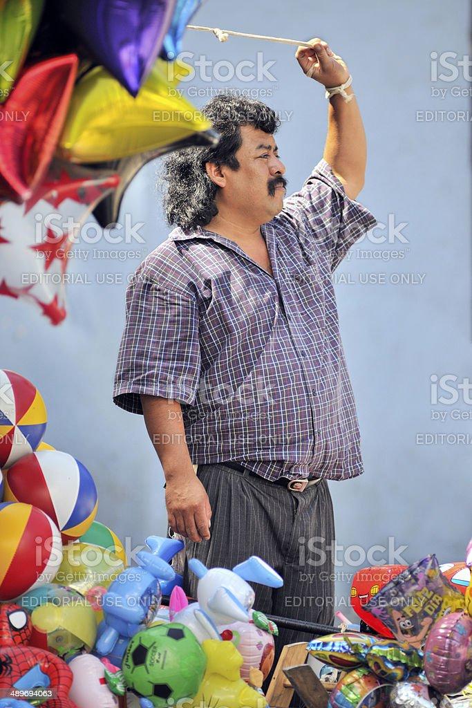 Balloon Seller in Oaxaca, Mexico stock photo