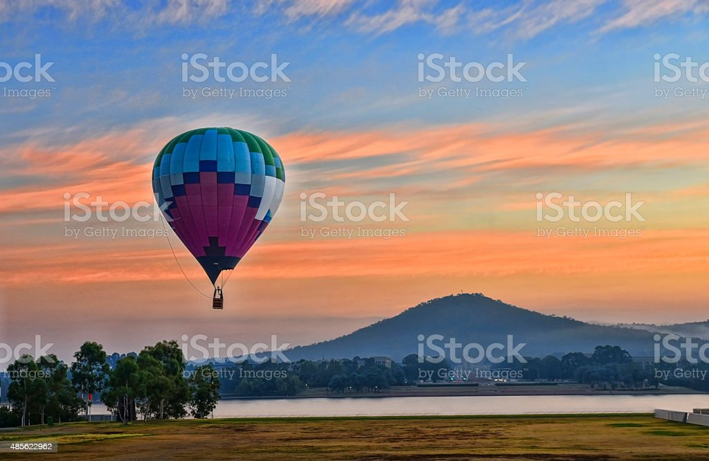 Balloon takes off just before sunrise stock photo
