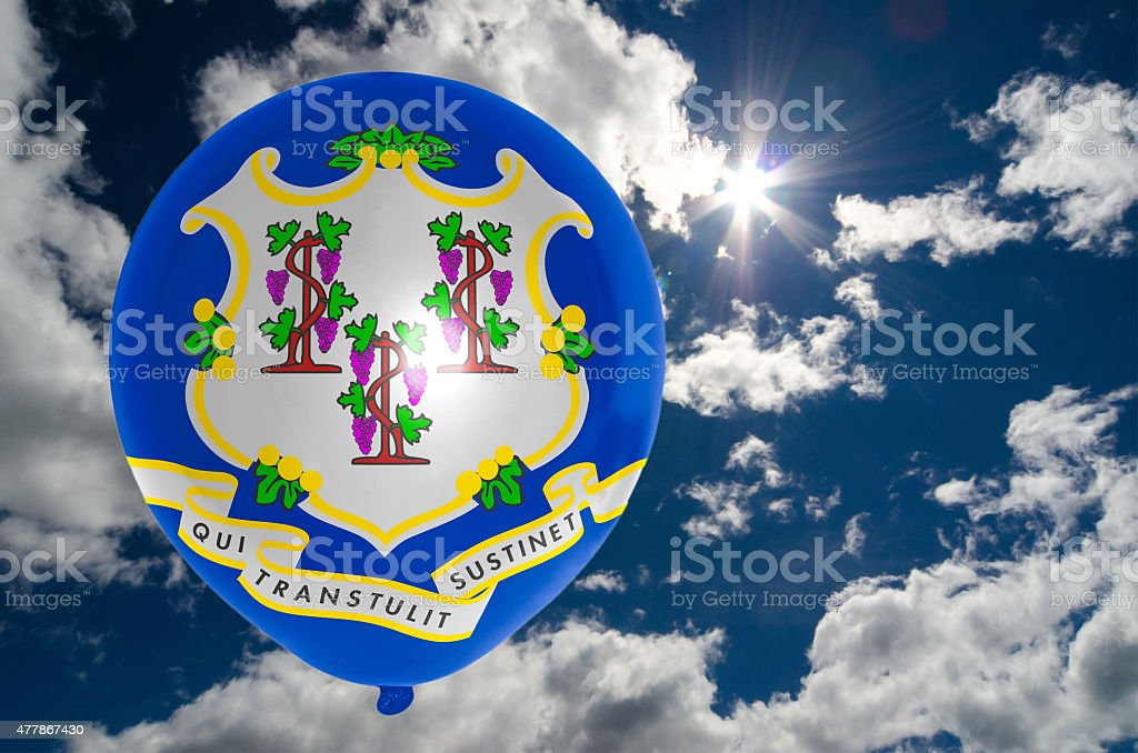 balloon with flag of connecticut on sky stock photo