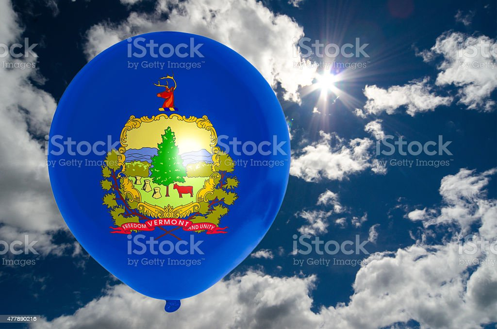 balloon with flag of vermont on sky stock photo