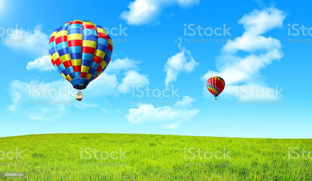 Balloons above the green meadow stock photo