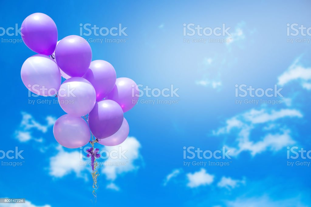 balloons against sky with clouds stock photo