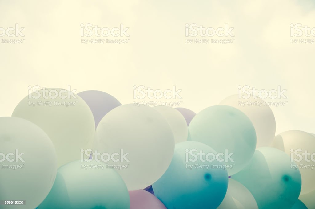 balloons background over pastel cloud stock photo