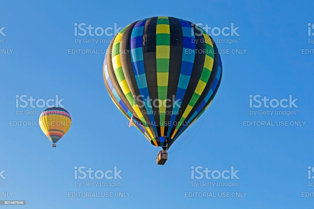 Balloons flying high above vineyards in California stock photo