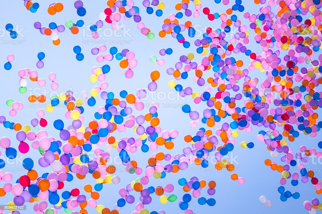 balloons flying in the sky stock photo