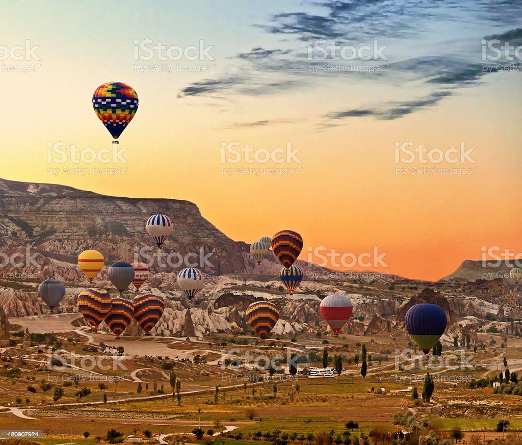 Balloons flying over Cappadocia Turkey stock photo