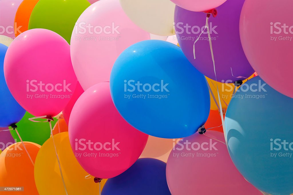Balloons in shades of pink, blue, green and yellow stock photo