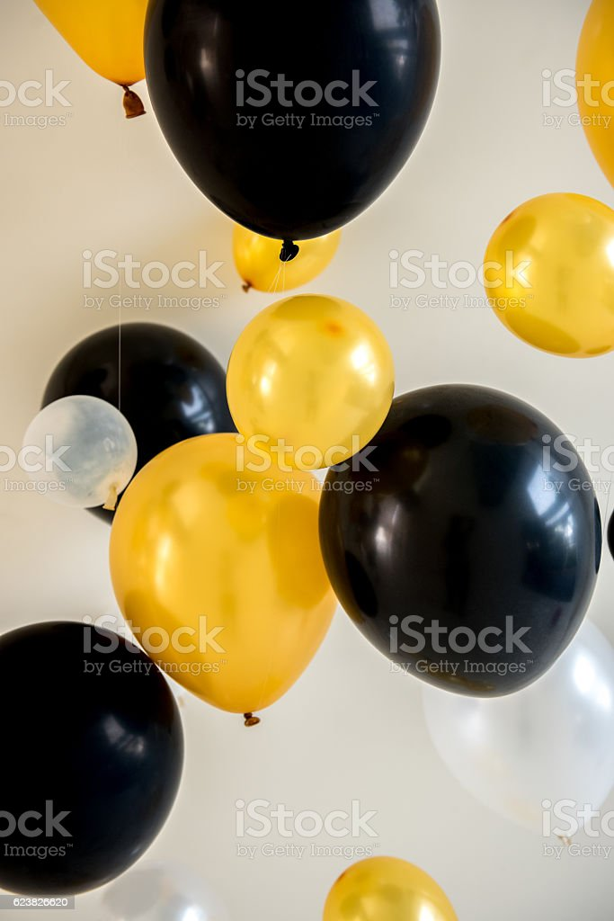 balloons yellow and black color on backdrop stock photo