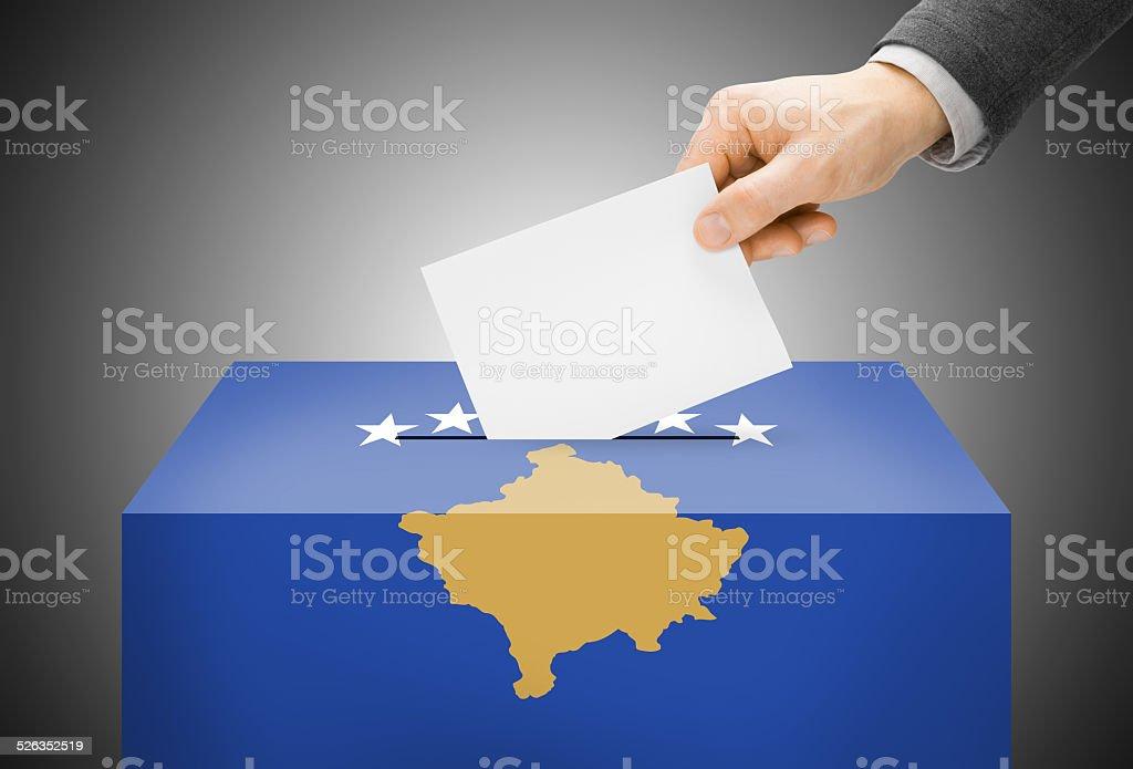 Ballot box painted into national flag colors - Kosovo stock photo