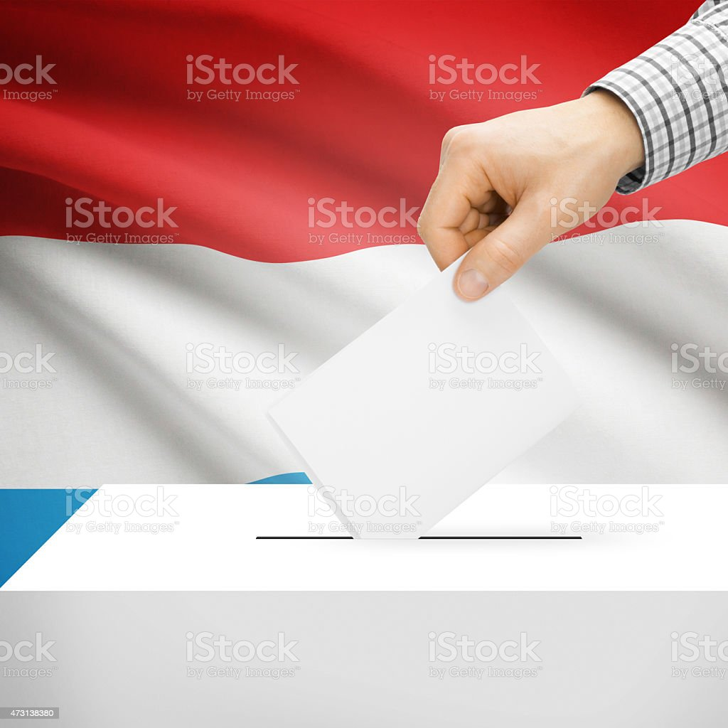 Ballot box with national flag on background - Luxembourg stock photo