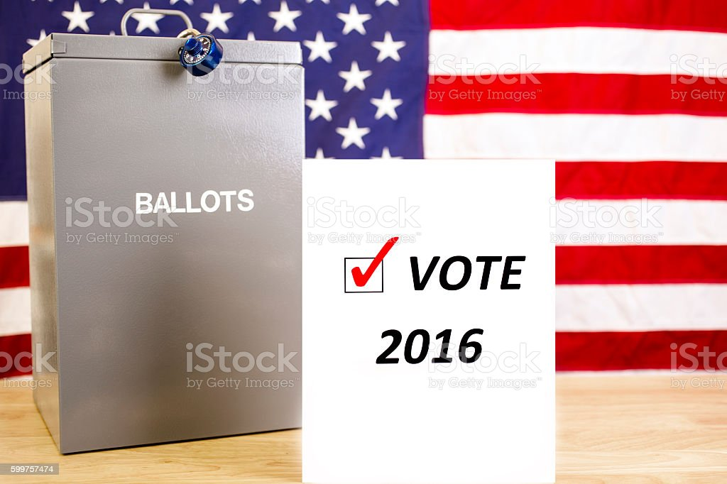 Ballot box with USA flag and sign represents voting concept. stock photo